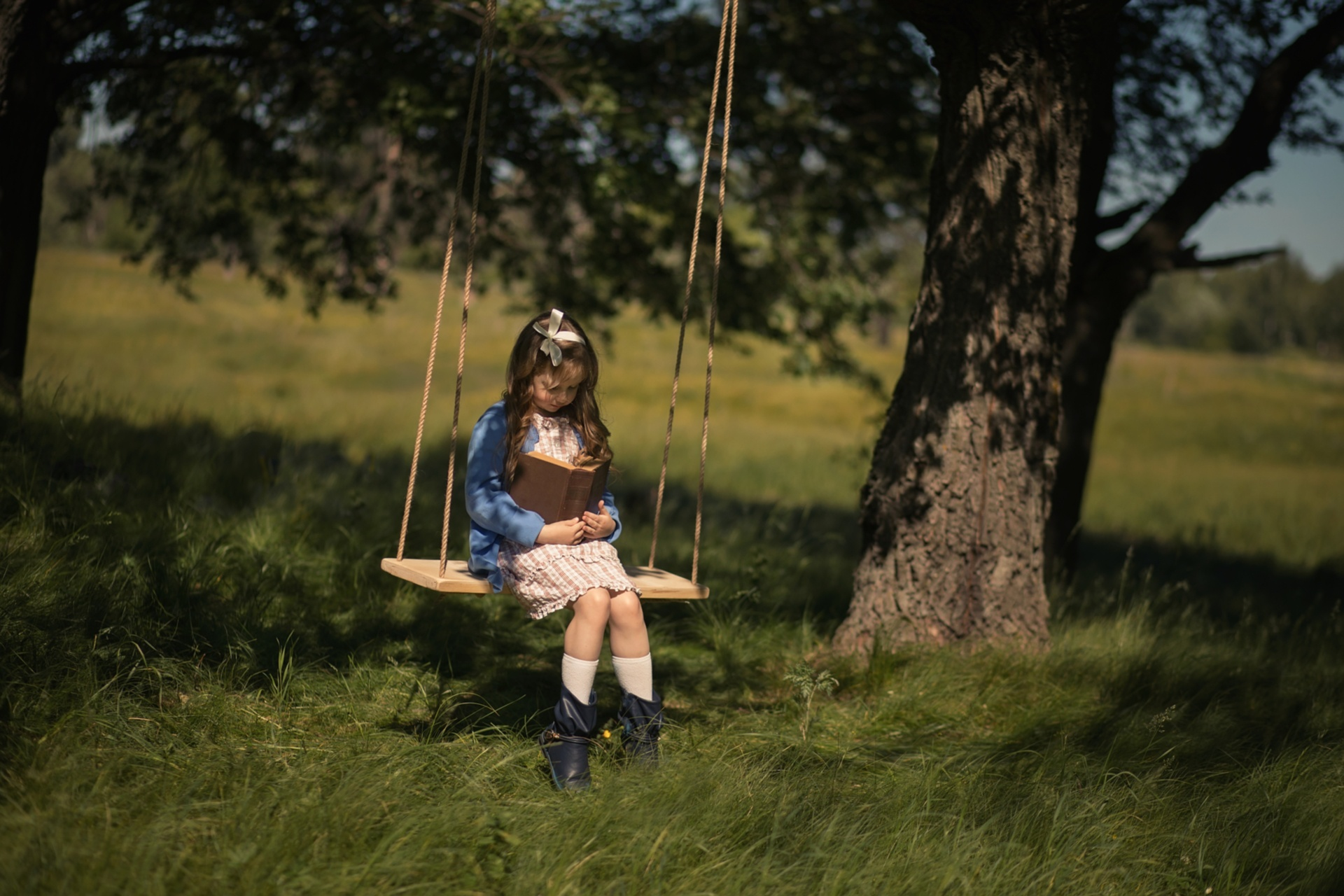 Girl swinging bat