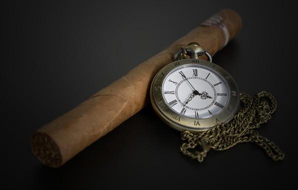 Picture cigar, the dark background, pocket watch