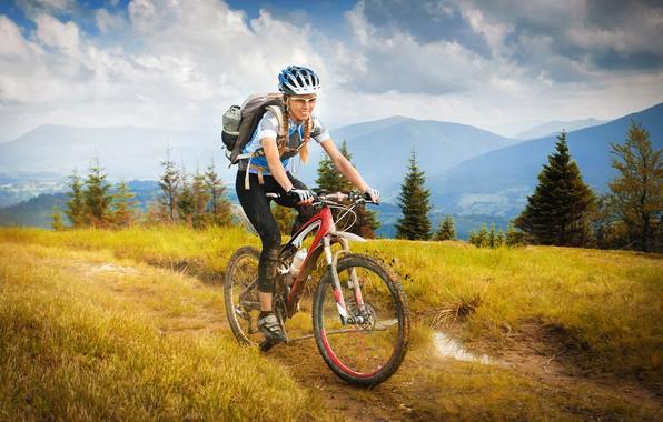 Picture grass, girl, clouds, trees, landscape, mountains, bike, sport, dirt, glasses, t-shirt, gloves, helmet, braids, backpack, …