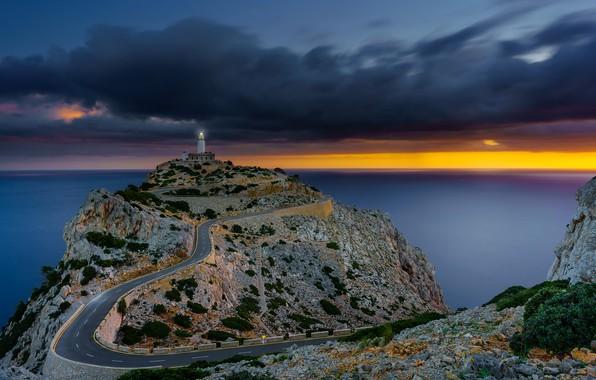 Picture road, sea, the sky, clouds, stones, rocks, dawn, coast, lighthouse, horizon, Spain, Mallorca, Mallorca, Sunrise