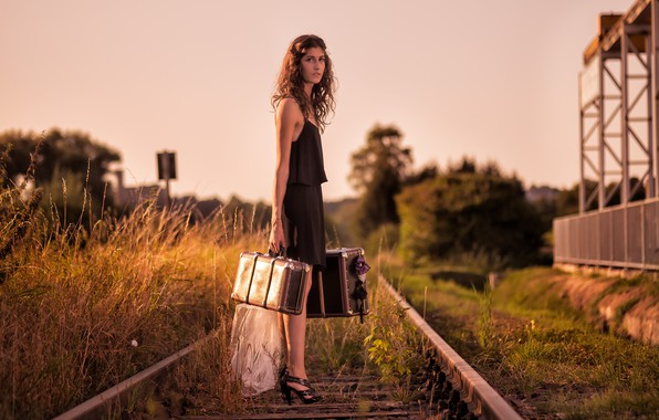 Picture girl, railroad, suitcases