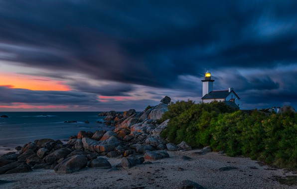 Picture sand, sea, light, night, clouds, lights, stones, the wind, shore, lighthouse, the atmosphere, house, twilight, …