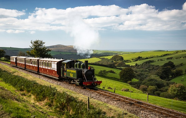 Picture the sky, the sun, clouds, trees, hills, field, England, rails, train, the engine, cars, railroad, …