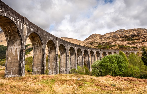 Picture the sky, clouds, trees, mountains, bridge, rocks, hills, old, arch, stone, ancient, arched