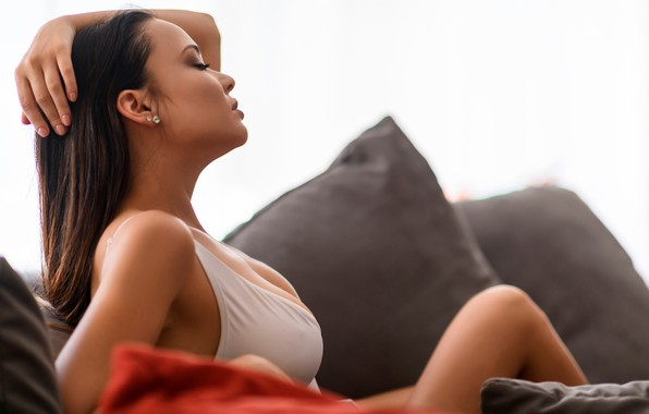 Picture pose, model, pillow, makeup, brunette, hairstyle, beauty, sitting, on the couch, bokeh, he closed his …