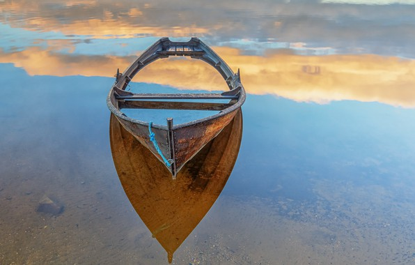 Picture the sky, shore, boat