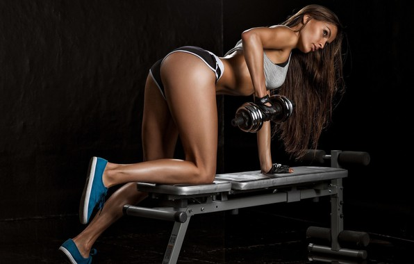 Picture the dark background, fitness, athlete, beautiful girl, machine, lesson, beautiful girl, training, workout, fitness, dark …