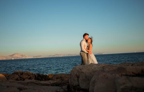 Picture love, romance, calm, silence, horizon, hugs, lovers, coast, girl in a dress, beautiful couple