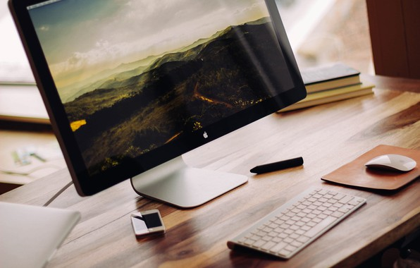 Picture table, books, apple, mouse, keyboard, monitor, iphone, imac