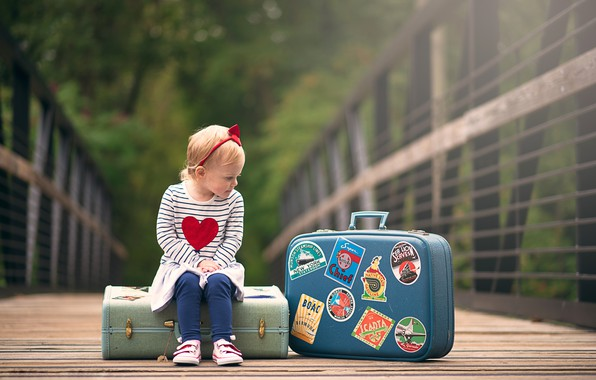 Picture girl, sitting, suitcases