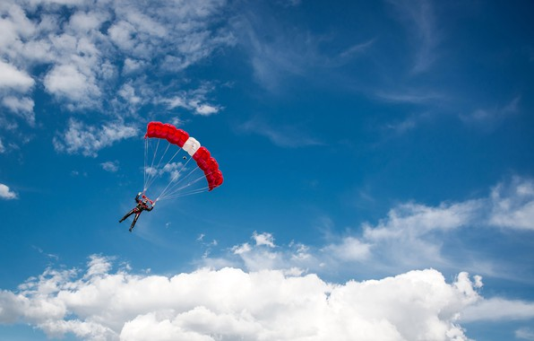 Picture the sky, the sun, clouds, sport, parachute, costume, athlete, skydiving