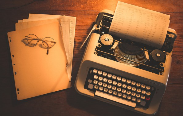 Picture glasses, leaves, typewriter, documents, wooden table