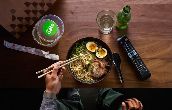 Picture noodles, remote control, utensils, oriental food, plato