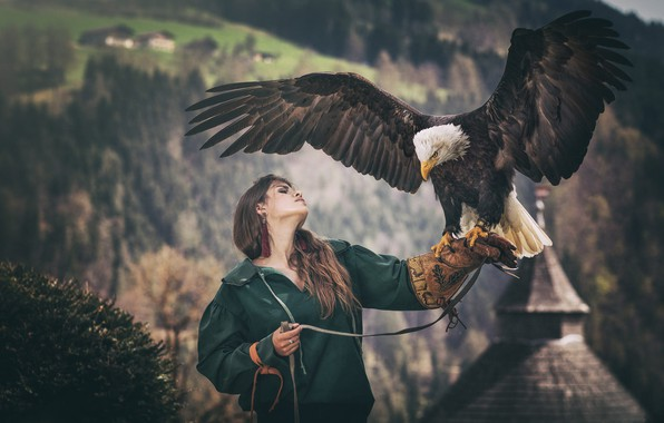 Picture forest, girl, mountains, nature, pose, the dark background, bird, eagle, portrait, wings, hands, jacket, brown ...