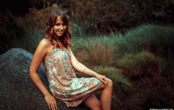 Picture grass, look, smile, model, stone, portrait, makeup, dress, hairstyle, brown hair, nature, posing, bokeh, Andreas-Joachim …