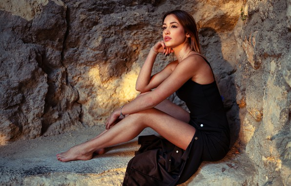Picture sexy, pose, stones, model, portrait, makeup, figure, dress, hairstyle, brown hair, legs, beauty, sitting, in …