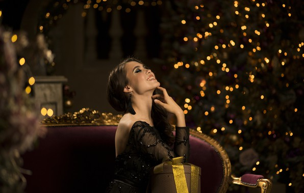Picture girl, joy, pose, smile, gift, tree, hand, Christmas, lights, makeup, dress, hairstyle, decoration, garland