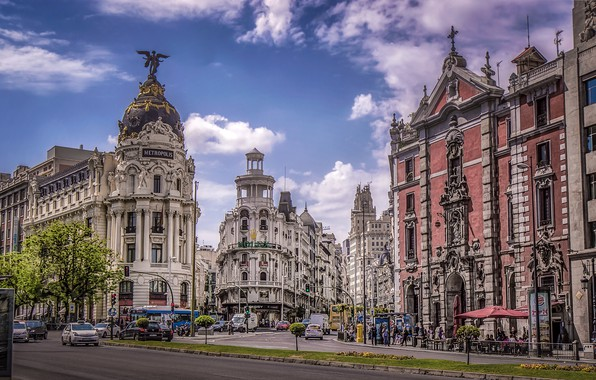 Picture the sky, the sun, clouds, machine, movement, people, road, home, Spain, street, Madrid