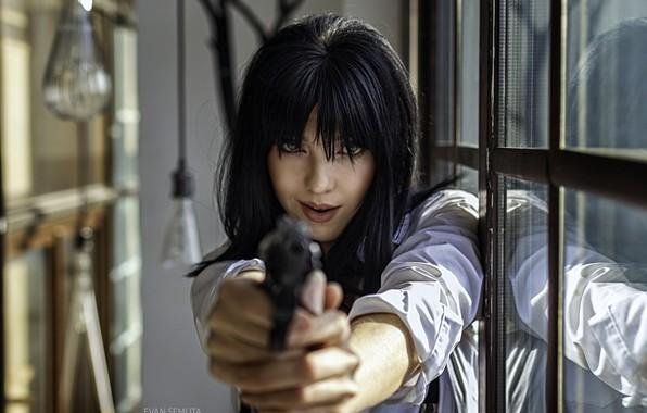 Picture black hair, mercenary, hell of a grin, Tanja, the barrel of a gun, Evan Semura