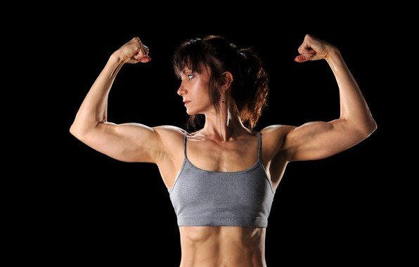 Picture sport, woman, body, muscles, biceps, bodybuilder, piercing in the navel