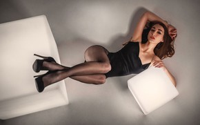 Picture look, pose, model, makeup, figure, hairstyle, shoes, lies, tights, brown hair, legs, mesh, on the …