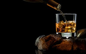 Picture stones, glass, bottle, black background, whiskey