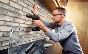 Picture man, bosch, drill, brick wall