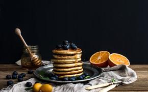 Picture oranges, blueberries, honey, plate, pancakes, jar