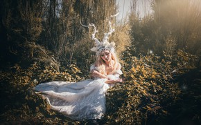 Picture grass, leaves, girl, light, trees, branches, nature, face, pose, style, thickets, hands, fairy, blonde, costume, …