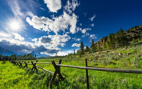 Picture the sky, clouds, mountains, fence