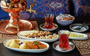Picture lemon, tea, sweets, nuts, samovar, baklava