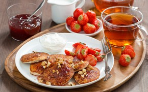 Picture tea, strawberry, jam, sour cream, pancakes
