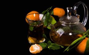 Picture tea, kettle, black background, tangerines