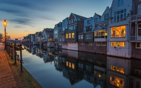 Picture the city, lights, the evening, water channel