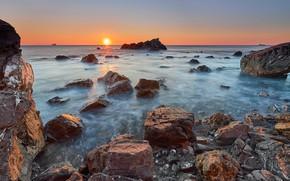 Picture sea, the sky, the sun, rays, landscape, sunset, nature, stones, rocks, shore, coast, rocky