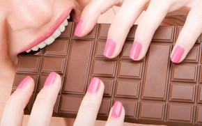 Picture hands, fingers, manicure, girl, teeth, chocolate, close-up, mouth