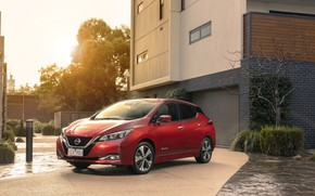 Picture the sun, the building, Nissan, Leaf
