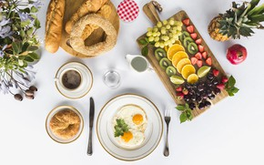 Picture cakes, cookies, coffee, scrambled eggs, buns, pineapple, oranges, grapes, strawberry