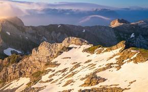 Picture light, snow, mountains, fog, stones, rocks, slope, haze, mountain range