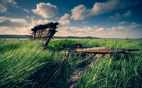 Picture the sky, grass, clouds, river, blue, thickets, shore, boat, Board, ship, the skeleton, the ship