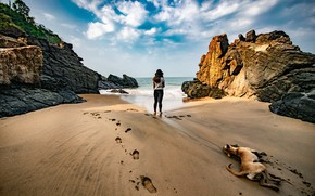 Picture sand, sea, beach, the sky, girl, clouds, traces, mood, rocks, stay, shore, back, dog, hat, …