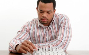 Picture chess, white background, male, Board, shirt, guy, sitting, figures, thought, chess player, at the table