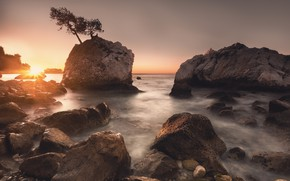 Picture sea, the sun, rays, light, trees, sunset, stones, tree, rocks, pine, pond, pine, boulders