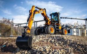 Picture the sky, stones, driver, cabin, excavator, works, wheel, bucket, JCB, machinery, the excavator boom, JCB …