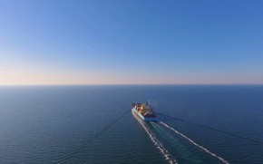Picture aerial view, after loading, container ship, floats in the open ocean