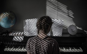 Picture keys, girl, braids, piano