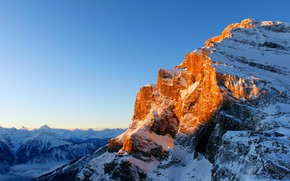 Picture the sky, the sun, snow, mountains, height