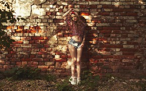 Picture sexy, pose, model, shorts, brick, makeup, figure, piercing, hairstyle, shirt, brown hair, legs, is, sneakers, …