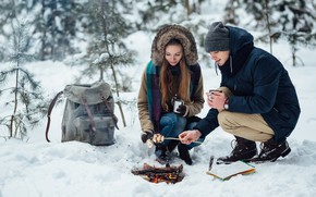 Picture winter, girl, snow, trees, fire, stay, map, pair, knife, Cup, guy, two, the fire, backpack, …