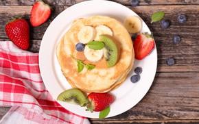 Picture kiwi, strawberry, banana, blueberries, pancake